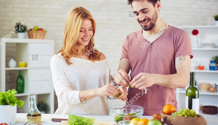 stock-photo-amorous-young-couple-cooking-salad-together-281800256