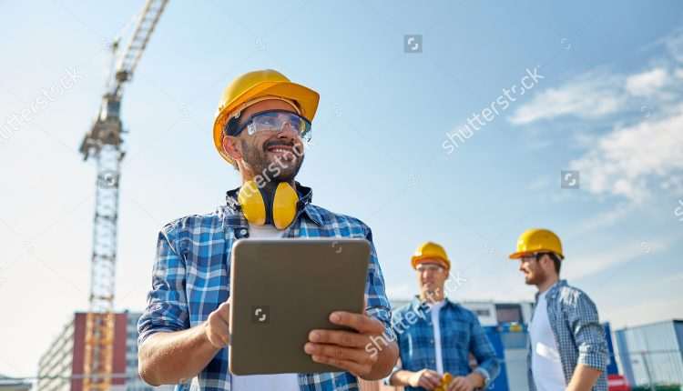 stock-photo-business-building-industry-technology-and-people-concept-smiling-builder-in-hardhat-with-304752284