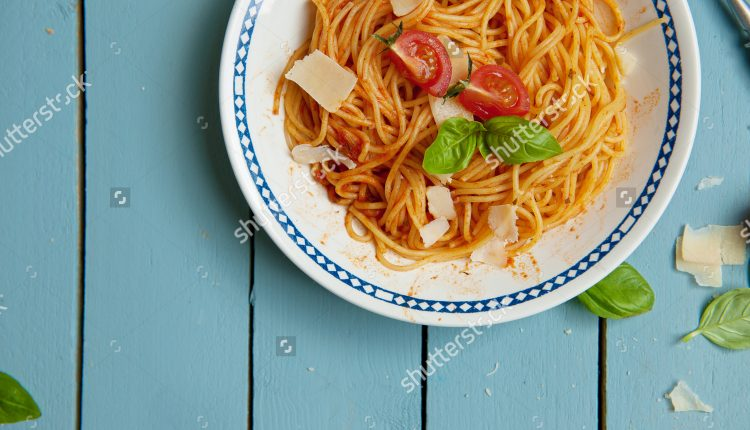 stock-photo-italian-cuisine-mediterranean-pasta-with-tomato-sauce-and-cheese-on-a-plate-190164272