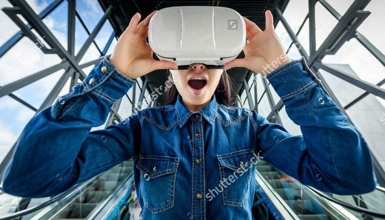 stock-photo-woman-wearing-virtual-reality-glasses-409291966