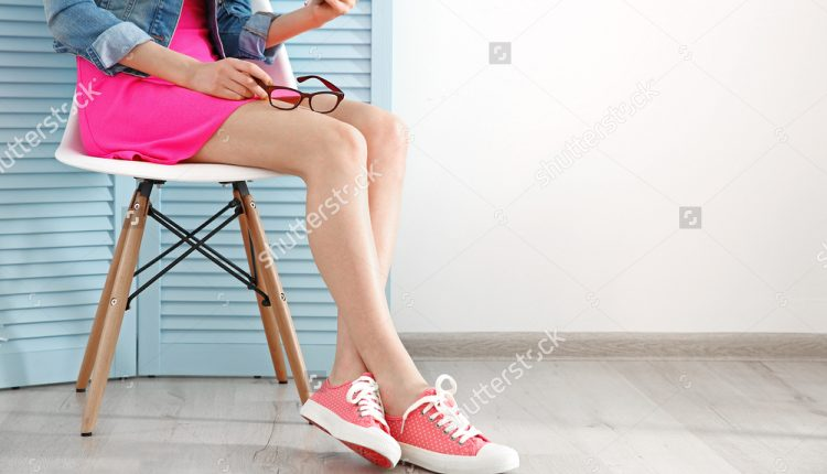 stock-photo-young-fashion-blogger-with-her-smart-phone-sitting-on-chair-indoors-420755851
