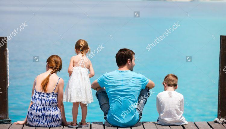 stock-photo-family-on-wooden-dock-enjoying-ocean-view-100059767 (1)
