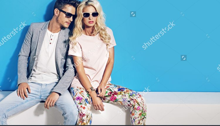 stock-photo-young-fashionable-couple-on-blue-background-285640730