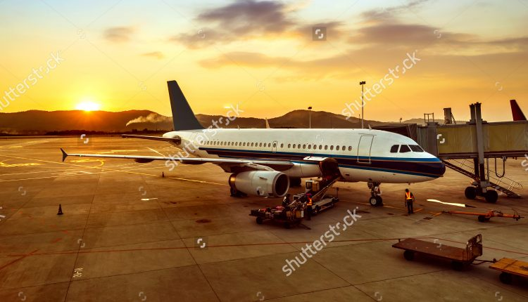 stock-photo-airplane-near-the-terminal-in-an-airport-at-the-sunset-162380006